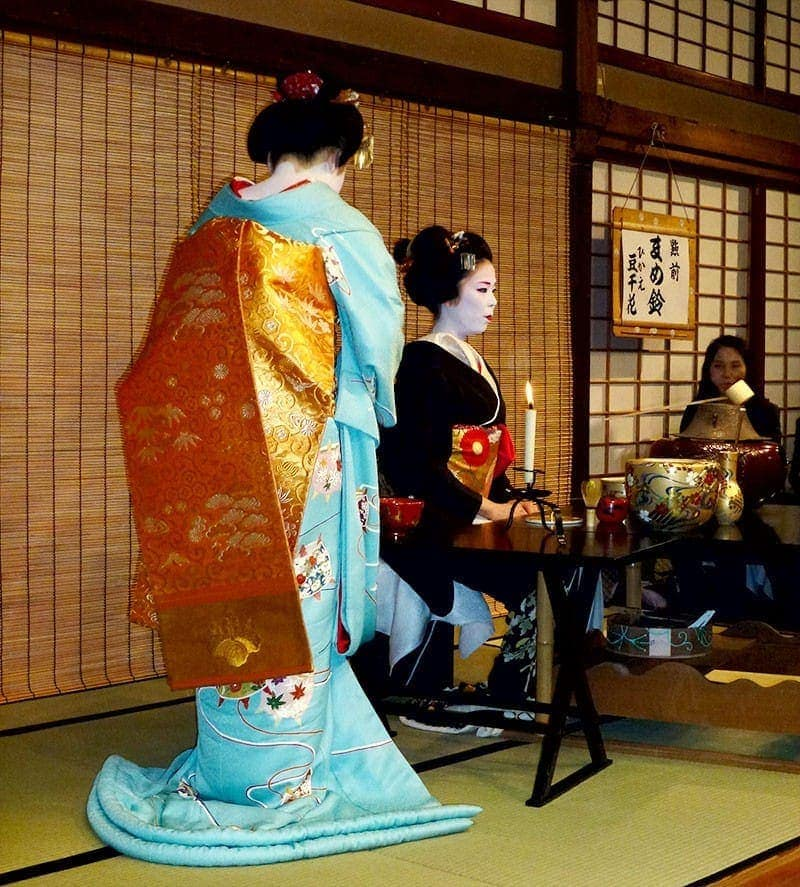 Geisha making matcha - a Japanese tea in the traditional style
