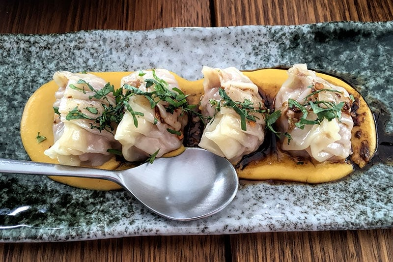 Pork dumplings, corn puree, chiu chow & black vinegar at Madam Wu