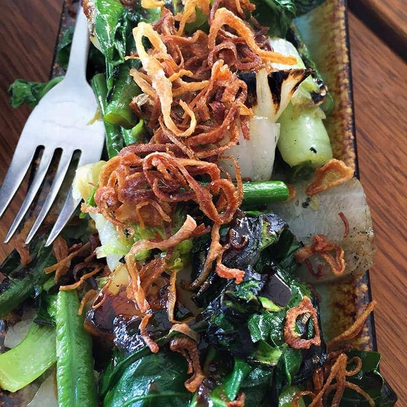 Stir fried wok greens, house made oyster sauce at Madame Wu In Brisbane