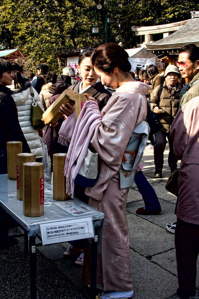 Selecting a fortune at Yasaka Shrine