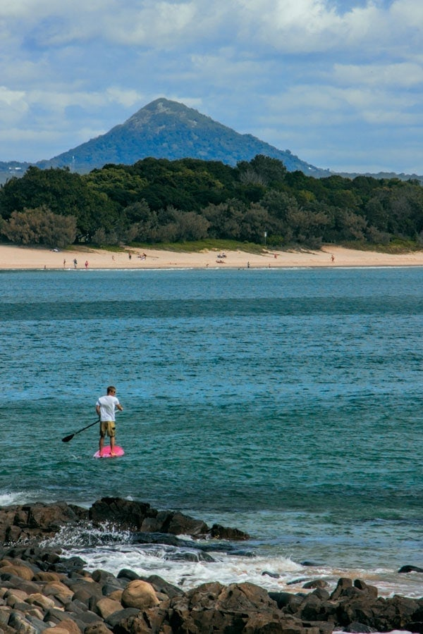 Stand up paddle boarding in Noosa - another great spot for a long weekend escape in Australia