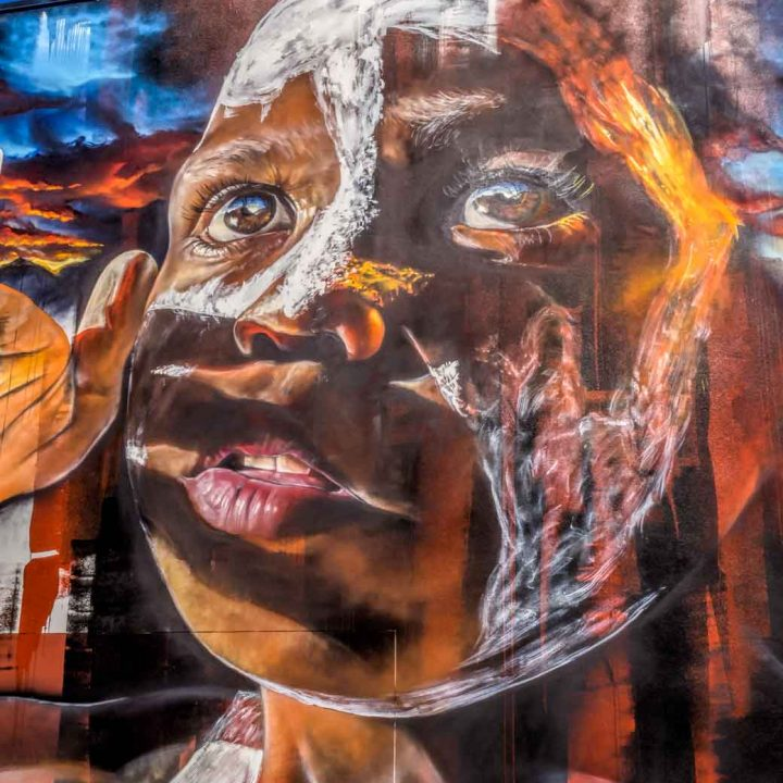 Street art mural of young boys face by Adnate in Toowoomba