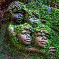 Large mossy pottery sculpture at William Ricketts Sanctuary featuring children