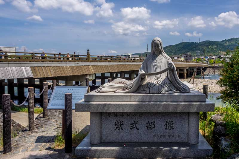 Murashiki Shikibu statue on the Uji Riverbank in Kyoto