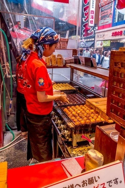 Takoyaki cooking on the grill
