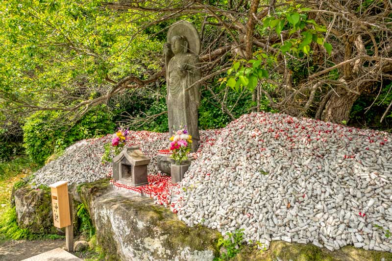 Jizo statue and onegai figurines