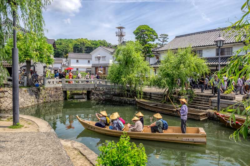 Traditional boat on canal at Kurashiki Bikan, Japan
