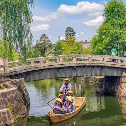 Traditional boat on the canal in Kurashiki Bikan