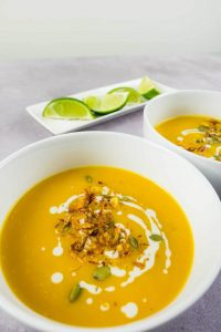 Bowls of homemade spicy Thai pumpkin soup
