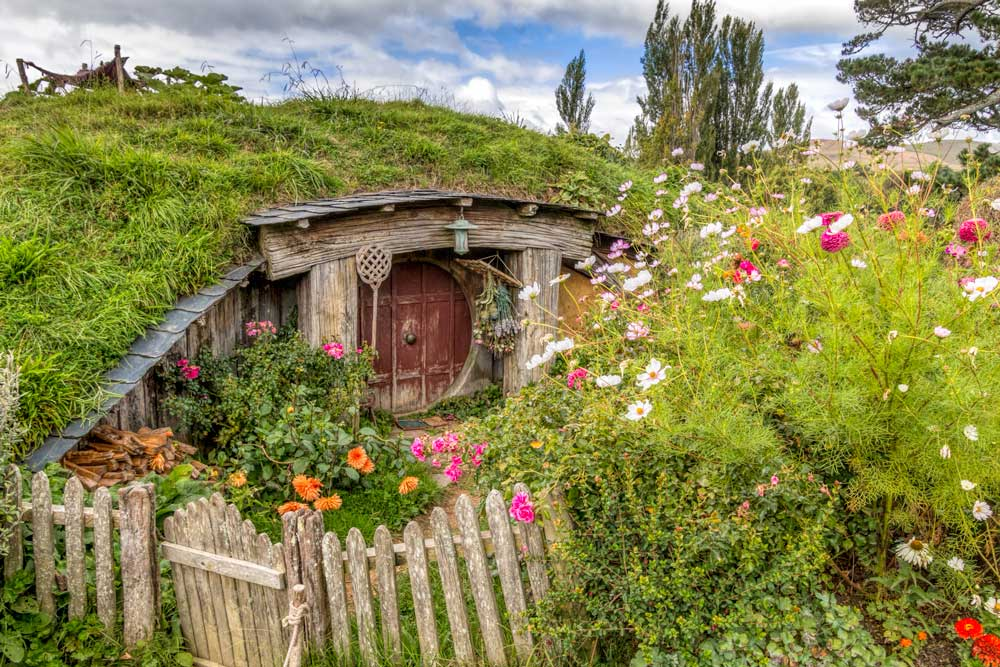 Hobbit hole surrounded by cottage garden flowers