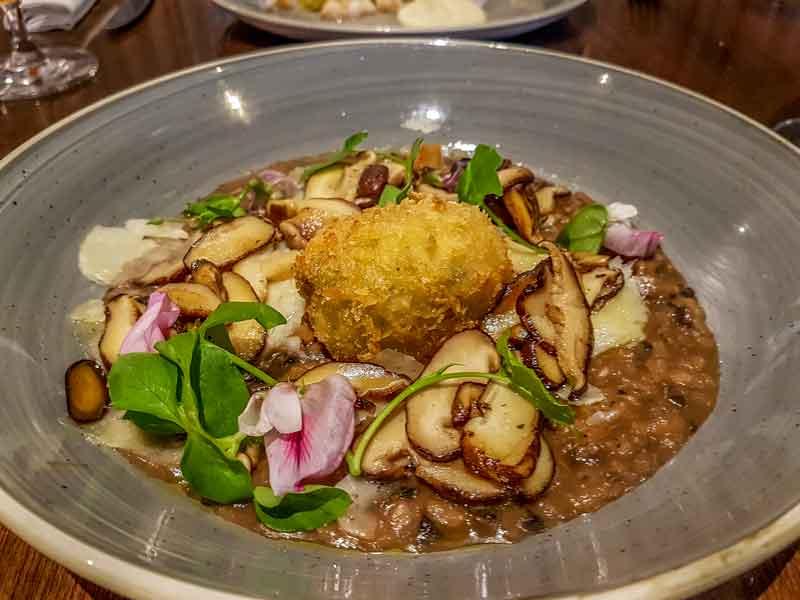 Wild mushroom rissoto with crumbed egg and pecorino