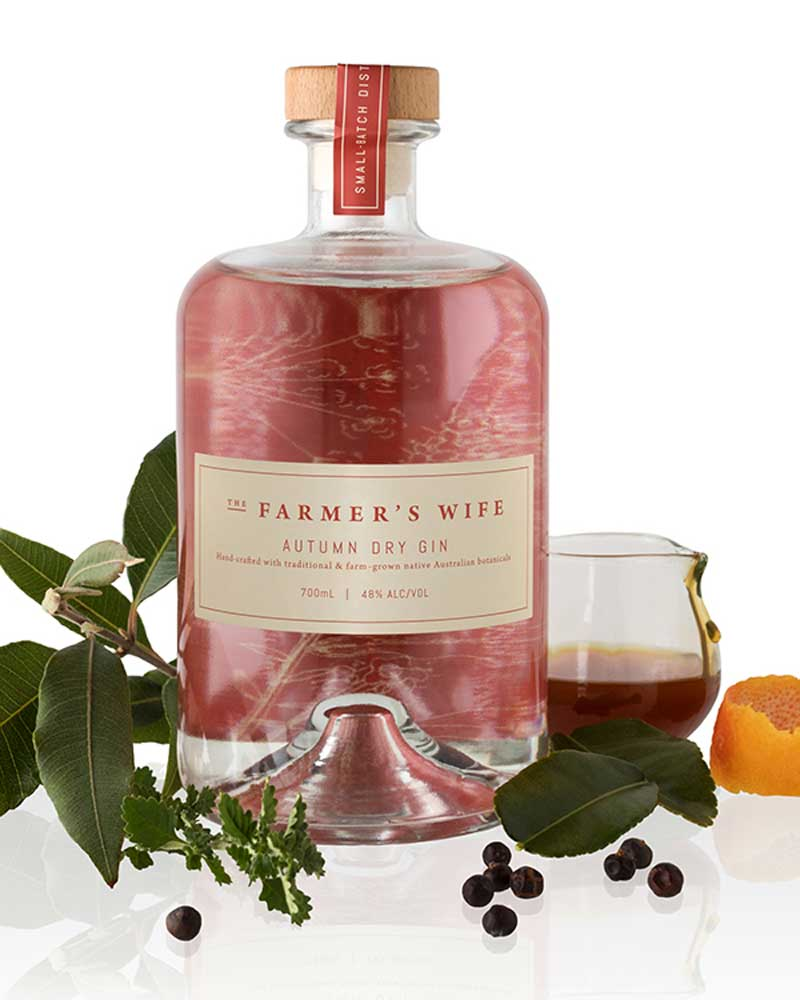 The Farmers Wifes craft autumn gin surrounded by botanicals