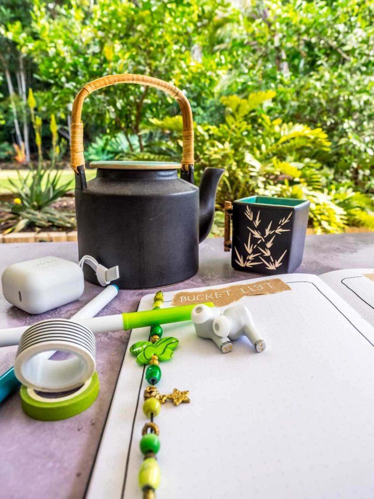 Bullet journal with teapot and sudio earphones