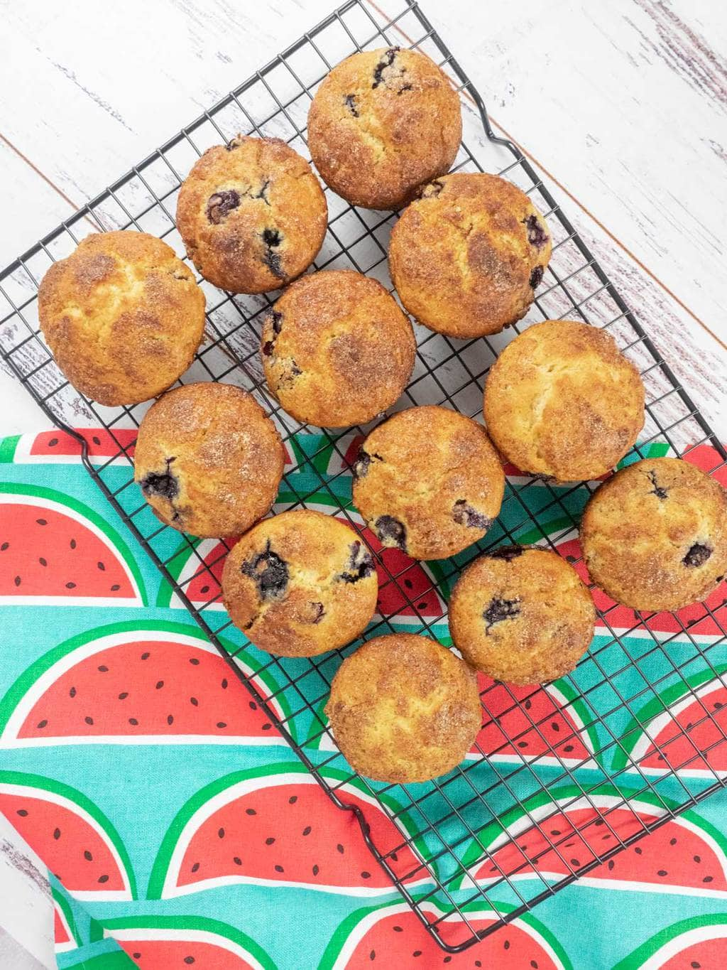 Blueberry and lemon muffins on cooling rack
