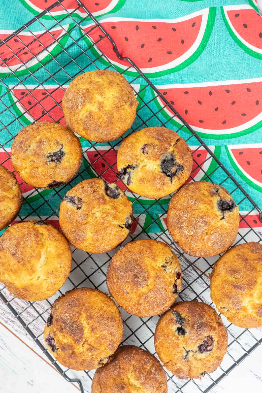Blueberry muffins with cinnamon crunch on cooling rack