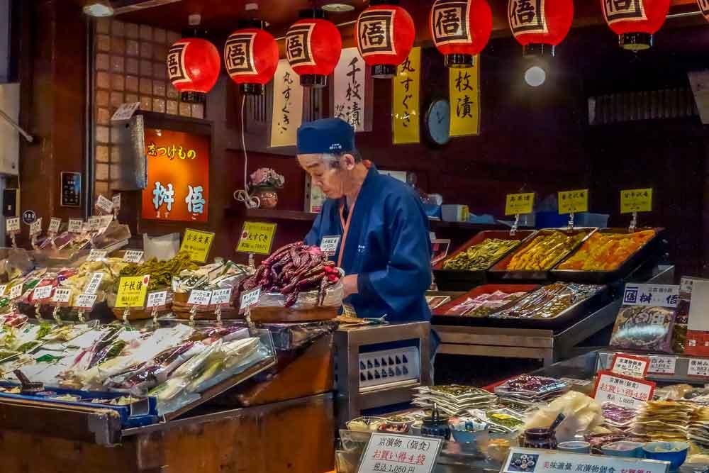 Vendor selling pickles at a shop in Nishiki market, Kyoto