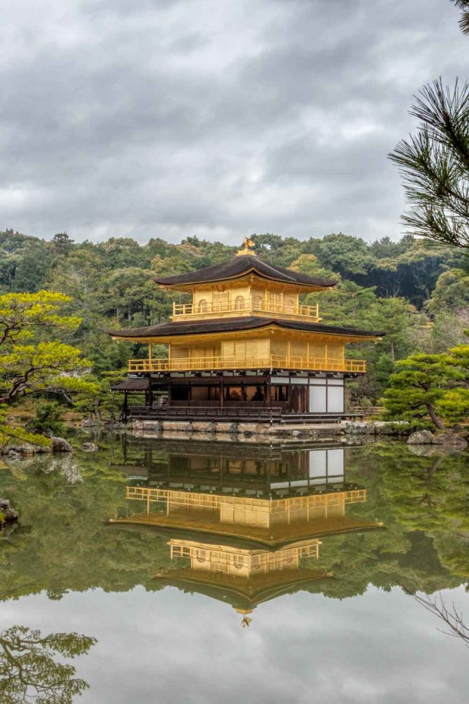 Golden pavilion reflected in the mirror pond at Kinkakuji