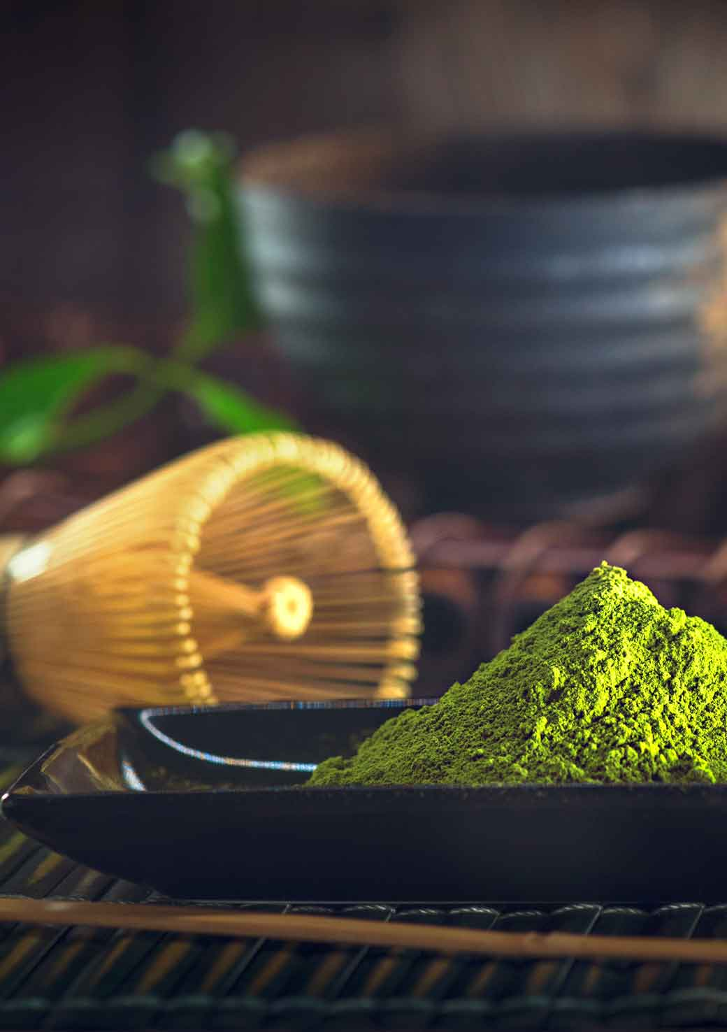 Matcha, bamboo whisk and ceramic tea bowl