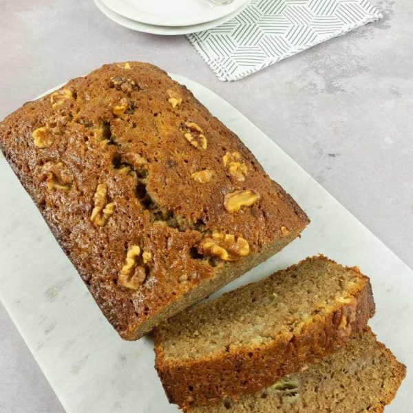 our easy banana loaf cut on marble serving tray