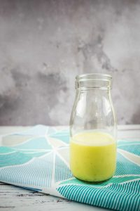 Lime dressing in a glass bottle
