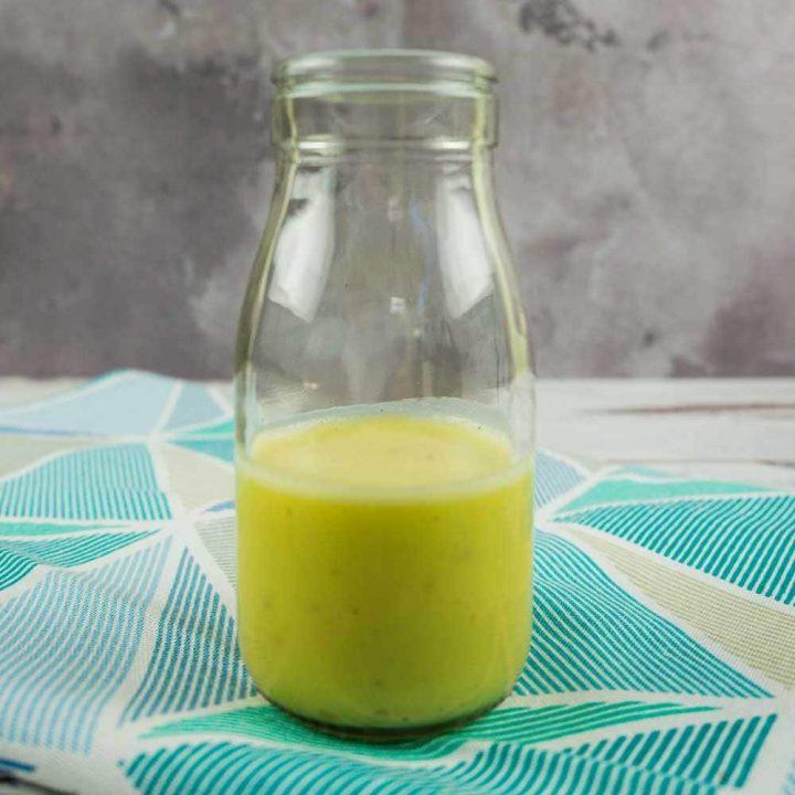 half full glass bottle of citrus dressing