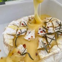 Baked camembert oozing melted cheese